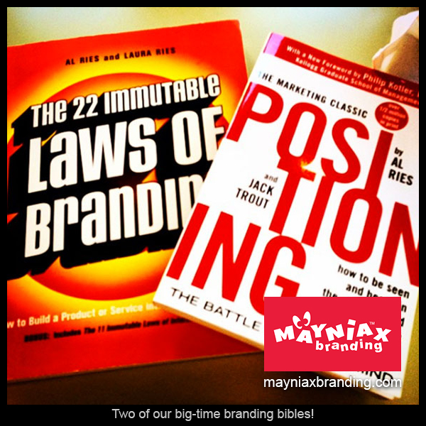 Two of our branding bibles: Positioning: The Battle for Your Mind and The 22 Immutable Laws of Branding